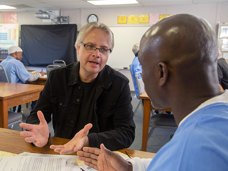 A faculty member in the classroom at San Quentin State Prison