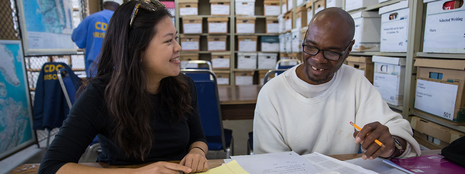 Faculty and student in study session at San Quentin