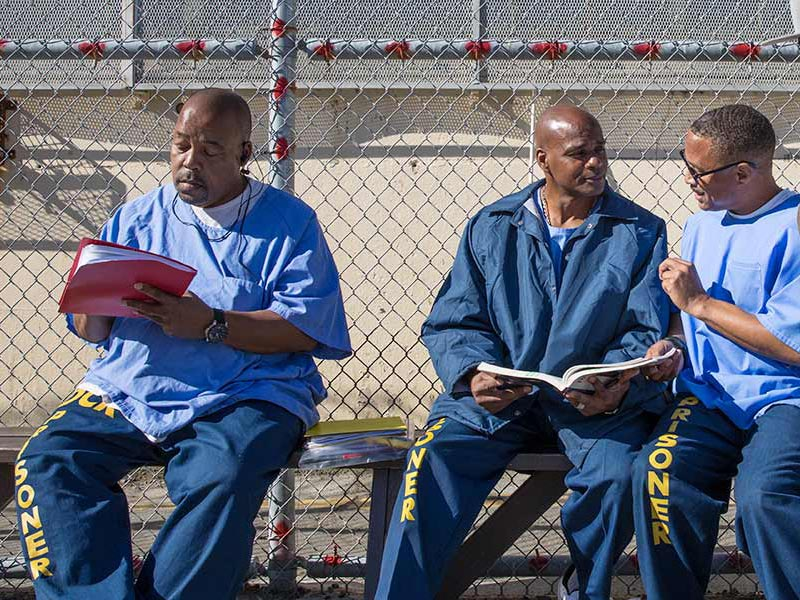 Mount Tamalpais College students studying in the yard at San Quentin State Prison